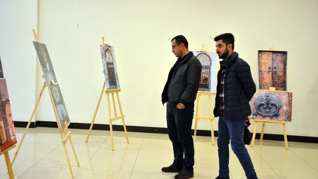 Teröristlerin ateşe verdiği tarihi caminin fotoğrafları sergilendi